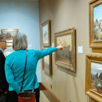 Guests admiring paintings at Friends of Alten 2018